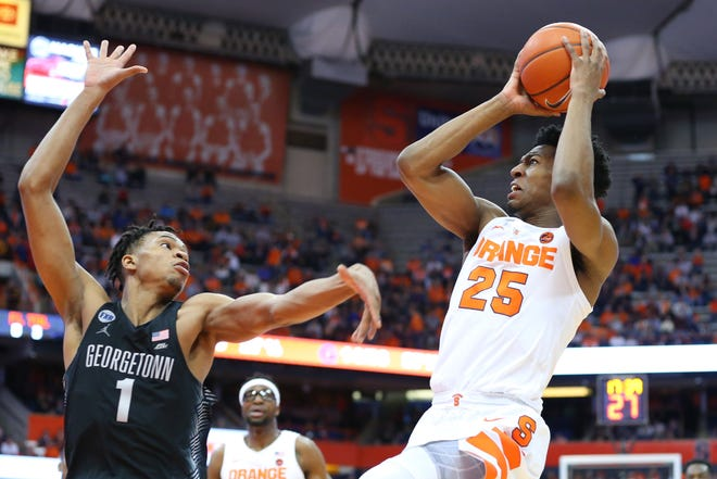 Syracuse Orange guard Tyus Battle (25) shoots the ball against Georgetown Hoyas guard Jamorko Pickett (1) during the second half at the Carrier Dome.