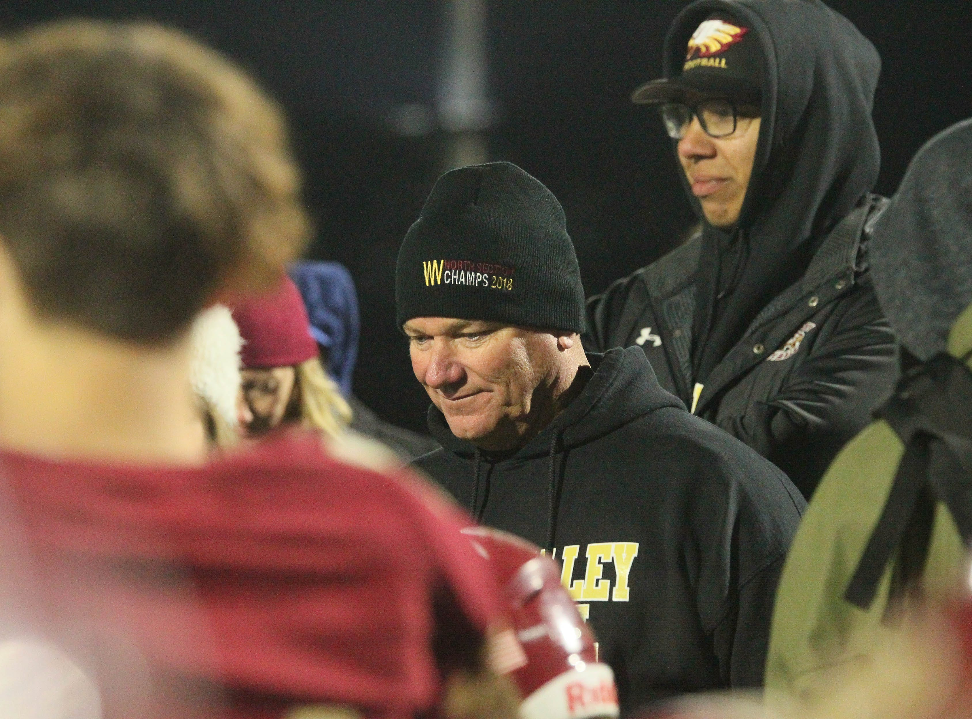 West Valley head coach, Greg Grandell, listens to other coach speaking to the team after the game.   Rio Linda beat the Eagles, 21-13, to take the NorCal regional title for Division 5-AA in Red Bluff on Friday, Dec. 7.
