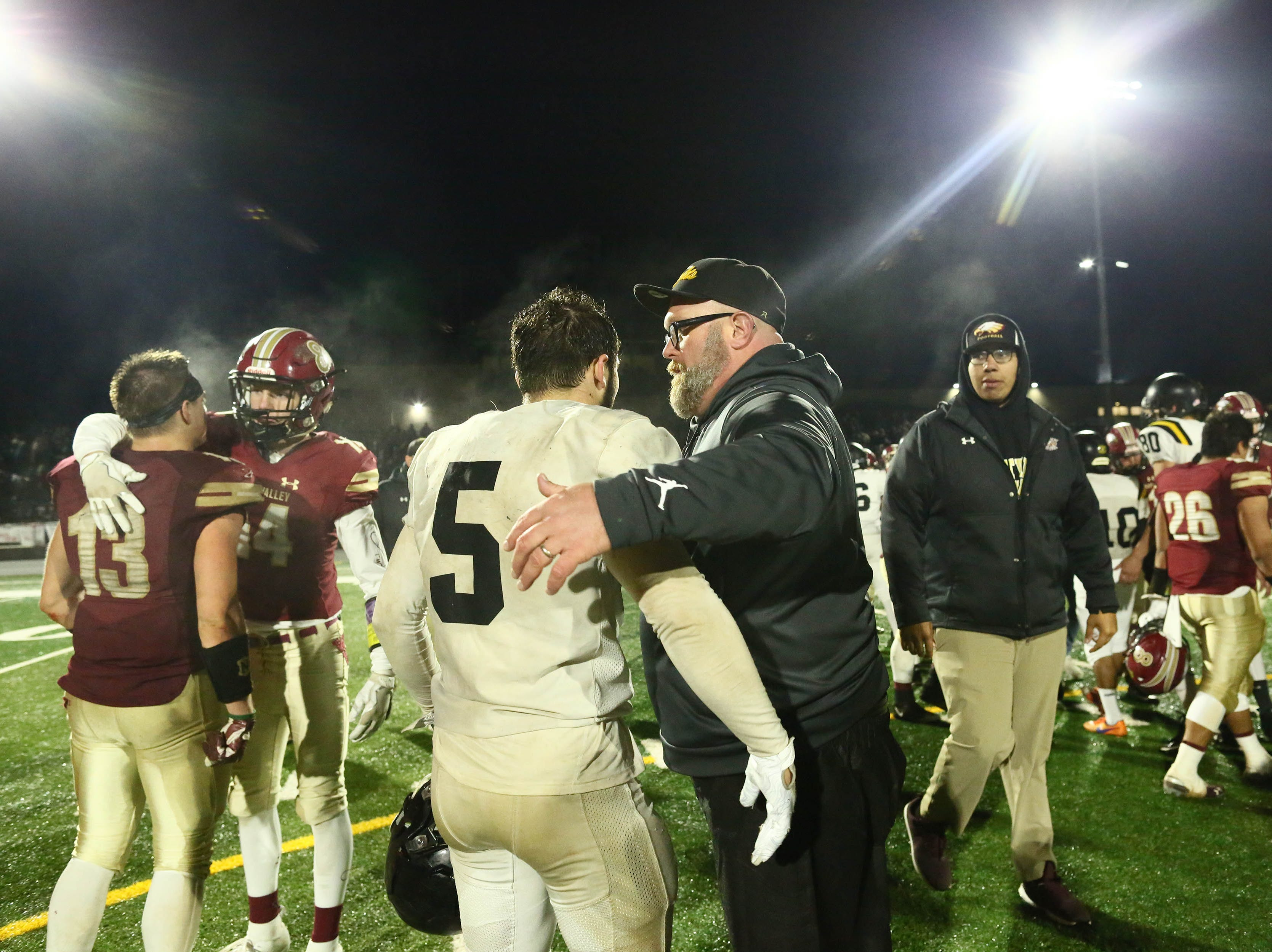 Rio Linda head coach, Jack Garceau talks to Cameron Skattebo (5) after the Knights won over West Valley on Friday night.   Rio Linda beat the Eagles, 21-13, to take the NorCal regional title for Division 5-AA in Red Bluff on Friday, Dec. 7.