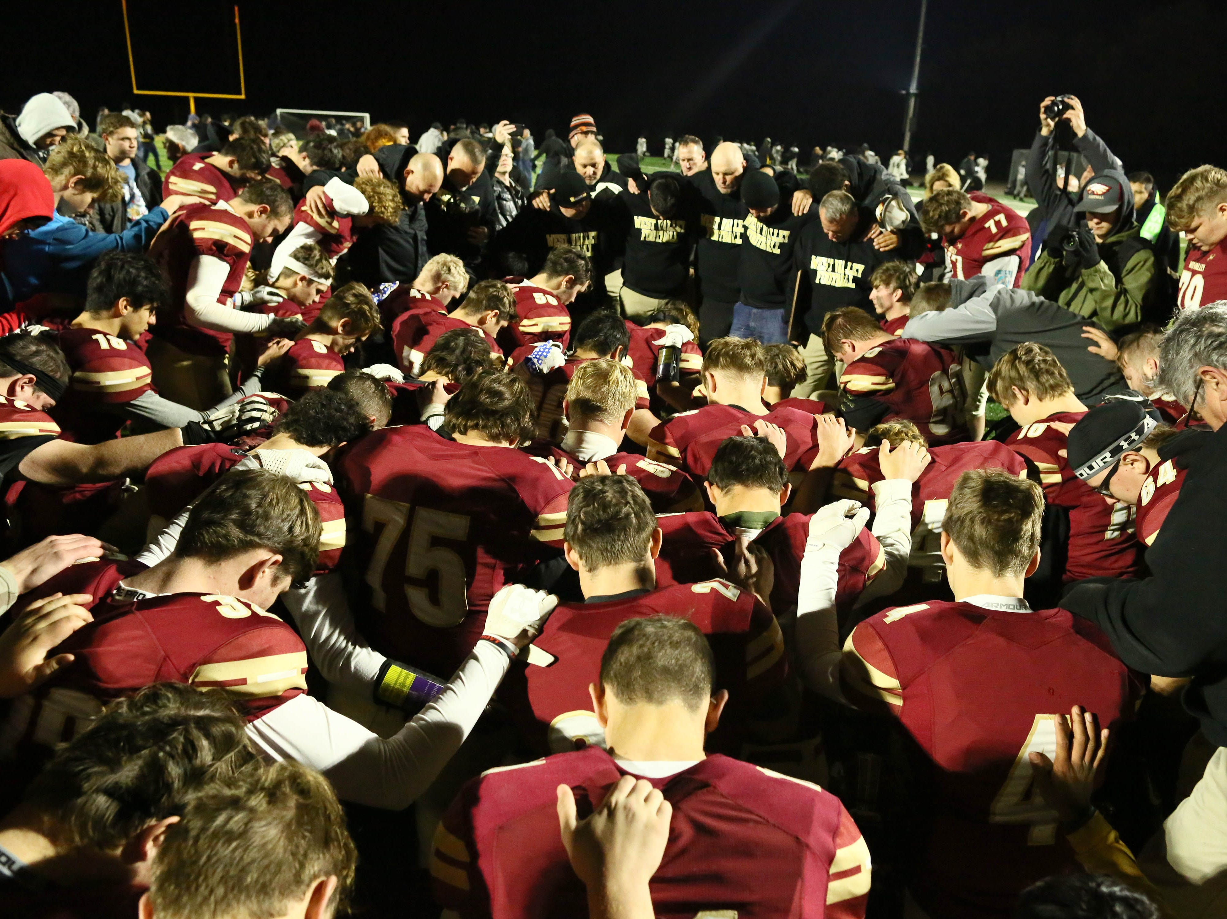 West Valley players and coaches gather on the field after the game for a prayer.  Rio Linda beat the Eagles, 21-13, to take the NorCal regional title for Division 5-AA in Red Bluff on Friday, Dec. 7.