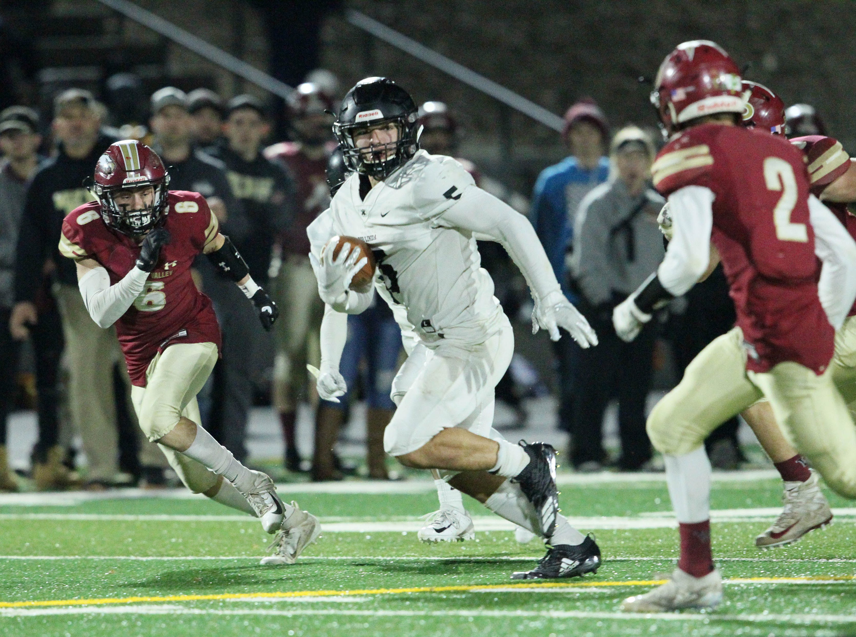 Rio Linda's Cameron Skattebo (5) runs for a 1st down against Devin Low (2) and Dagen Johnson-Sanders (6) in the 1st quarter.   Rio Linda beat the Eagles, 21-13, to take the NorCal regional title for Division 5-AA in Red Bluff on Friday, Dec. 7.