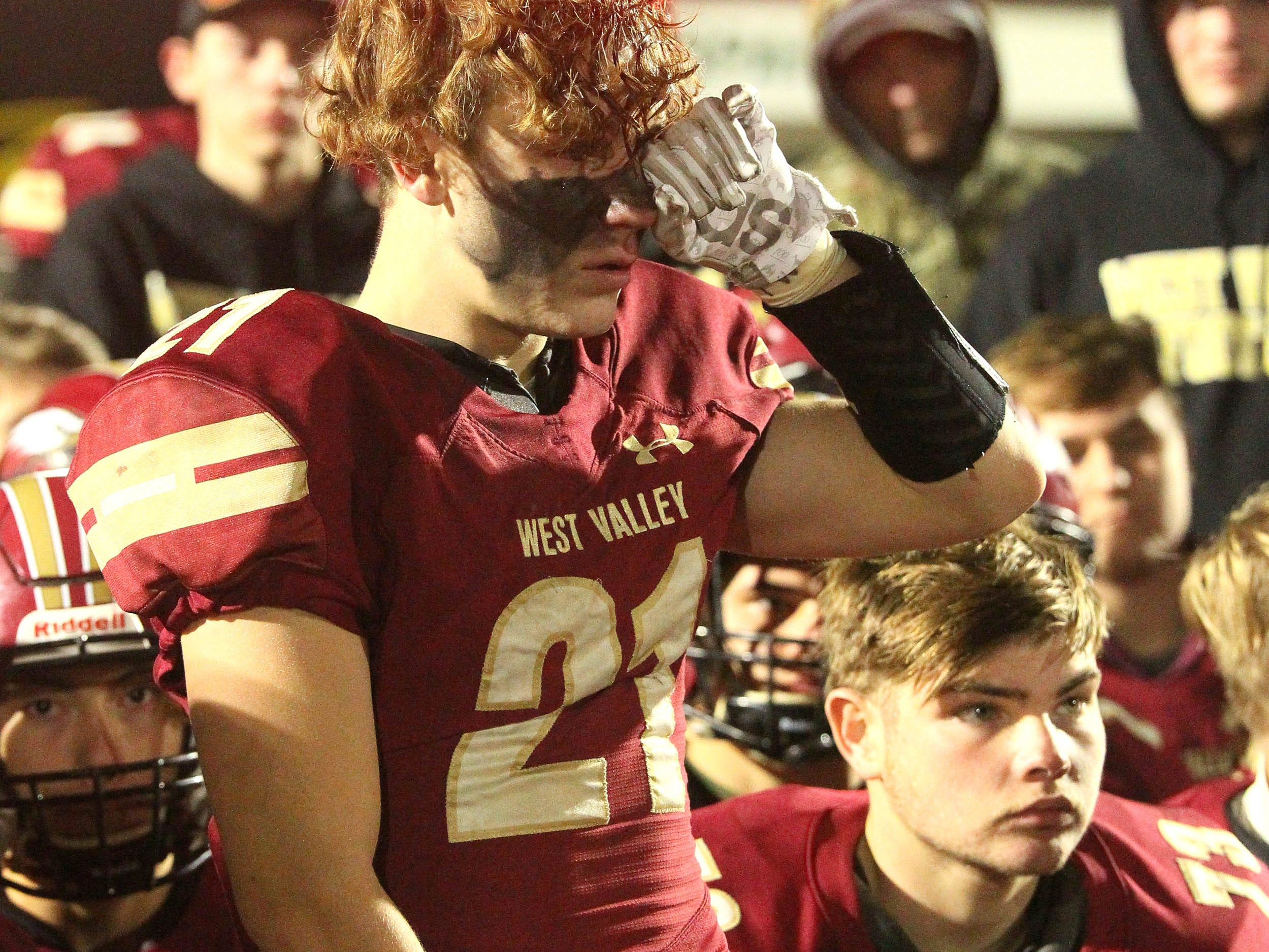 West Valley's Myles Gibbons (21) listens to coach on the field after West Valley lost to Rio Linda.   Rio Linda beat the Eagles, 21-13, to take the NorCal regional title for Division 5-AA in Red Bluff on Friday, Dec. 7.