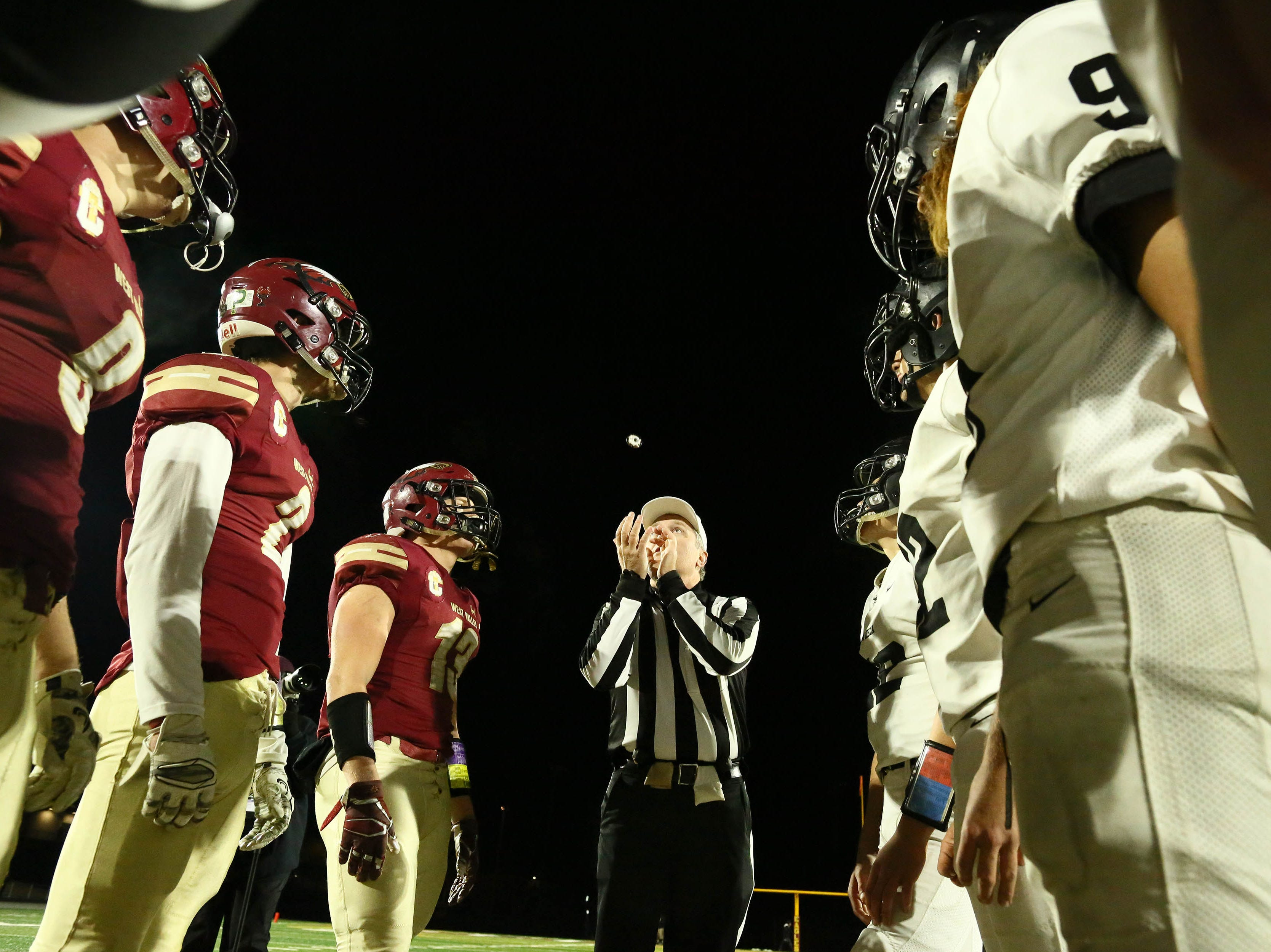 The referee tosses the coin before the game begins on Friday night.   Rio Linda beat the Eagles, 21-13, to take the NorCal regional title for Division 5-AA in Red Bluff on Friday, Dec. 7.