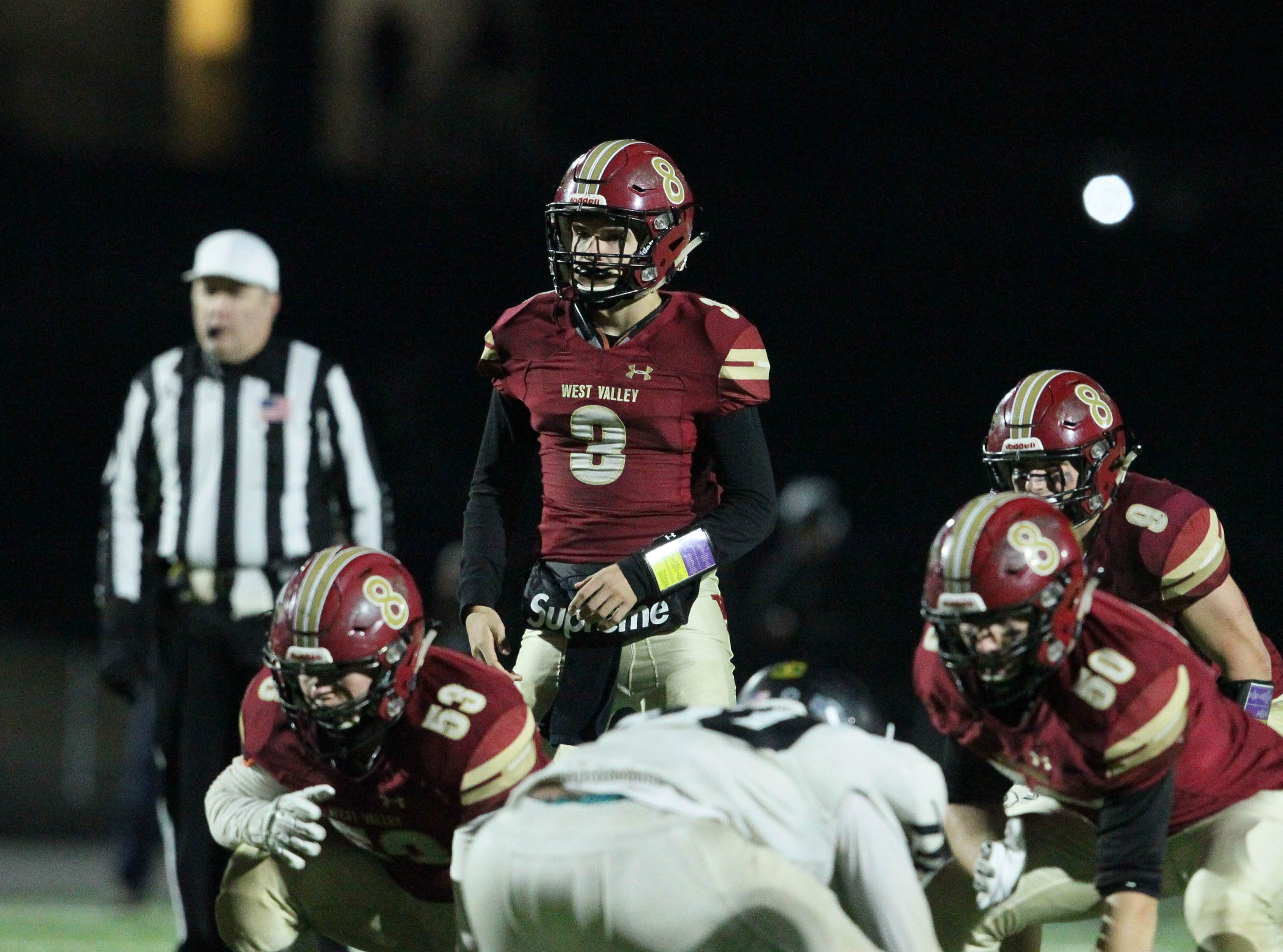 West Valley quarterback Kitt McCloughan surveys the field.   Rio Linda beat the Eagles, 21-13, to take the NorCal regional title for Division 5-AA in Red Bluff on Friday, Dec. 7.
