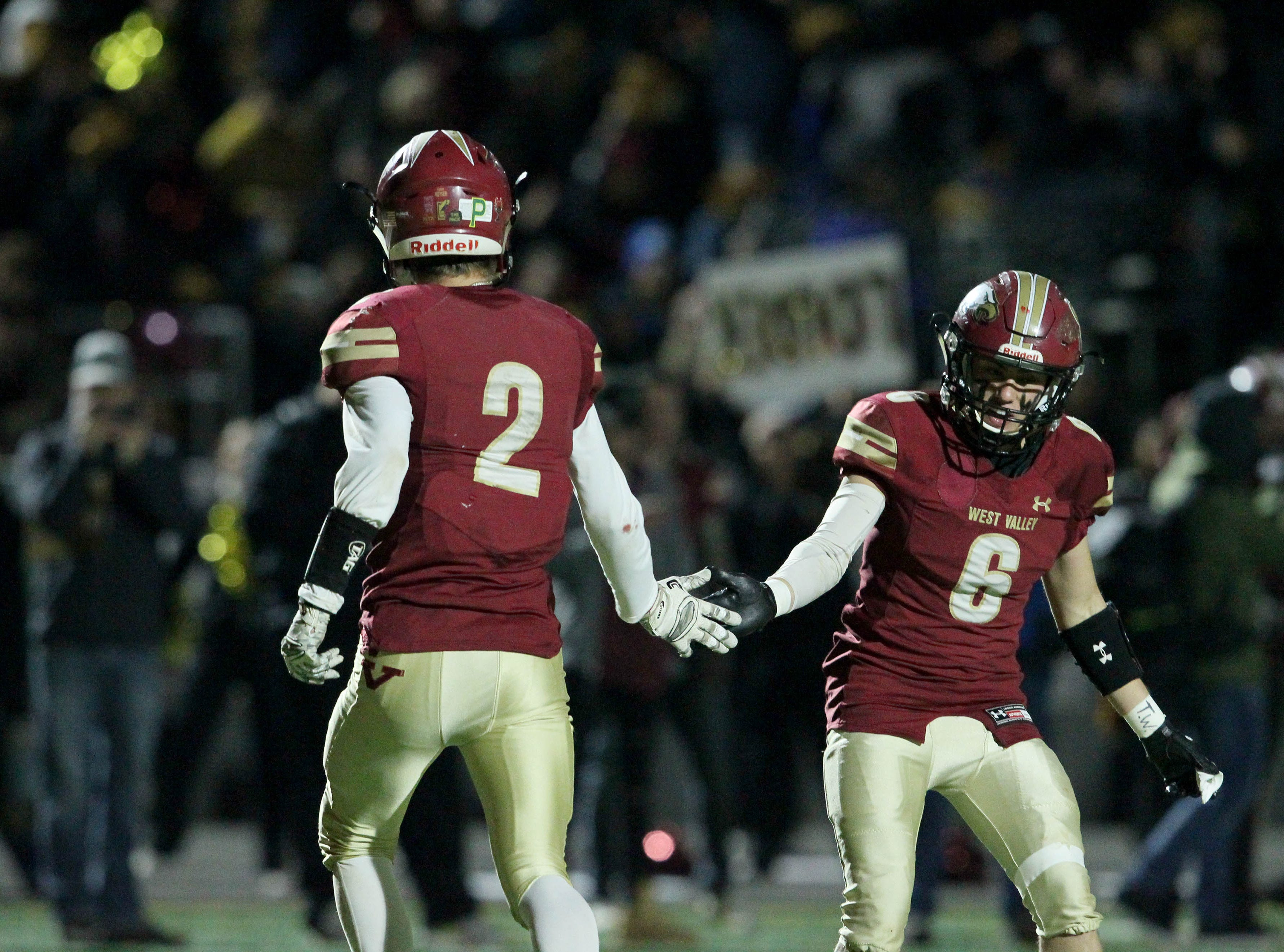 West Valley's Devin Low (2) and Dagen Johnson (6) high five in the first half of the NorCal regional title game for Division 5-AA in Red Bluff on Friday, Dec. 7.