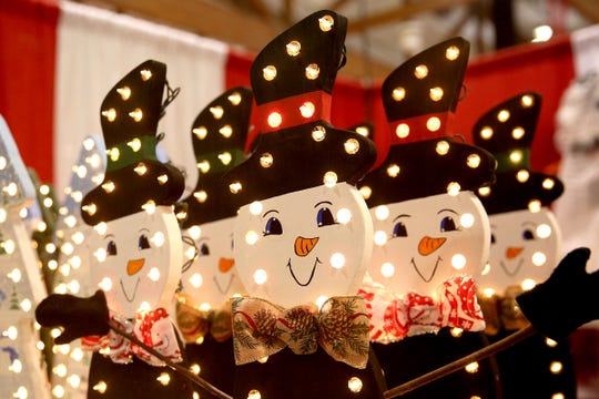Wooden snowmen photographed at the Salem Holiday Market on Dec. 8, 2018.