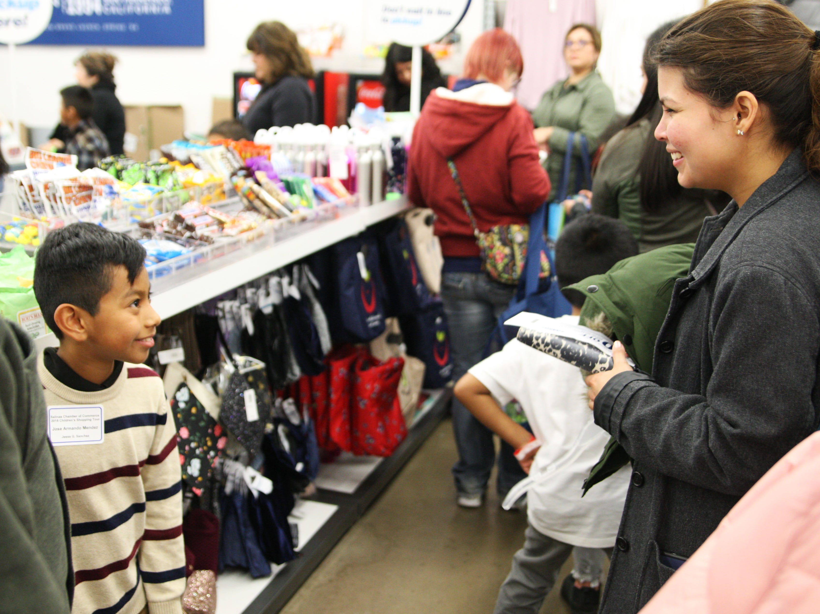 Salinas kids warm up with new clothes during Christmas shopping spree at Northridge Mall