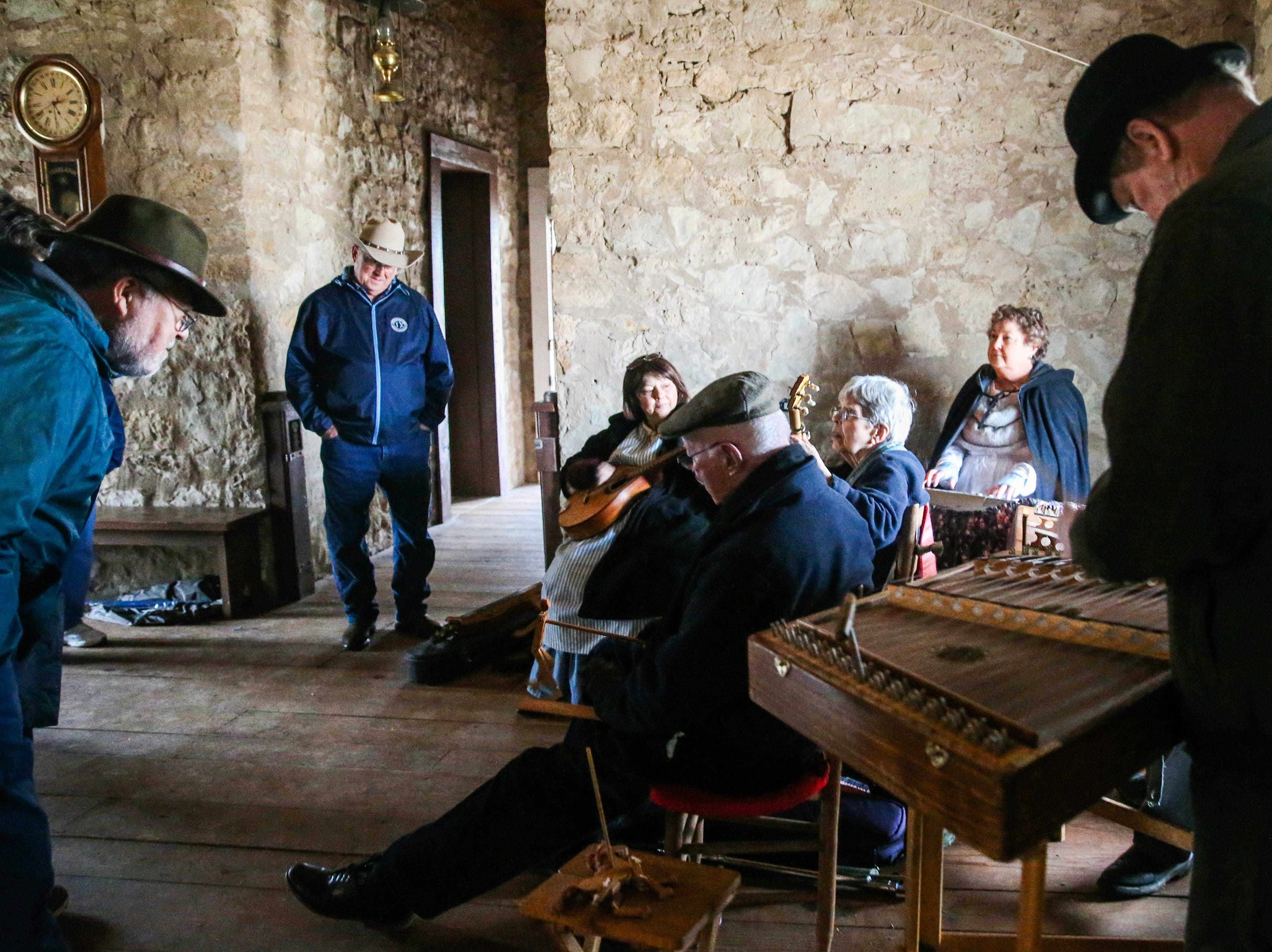 Musicians entertain the crowd in a fort building Friday, Dec. 7, 2018, during Christmas at Old Fort Concho.