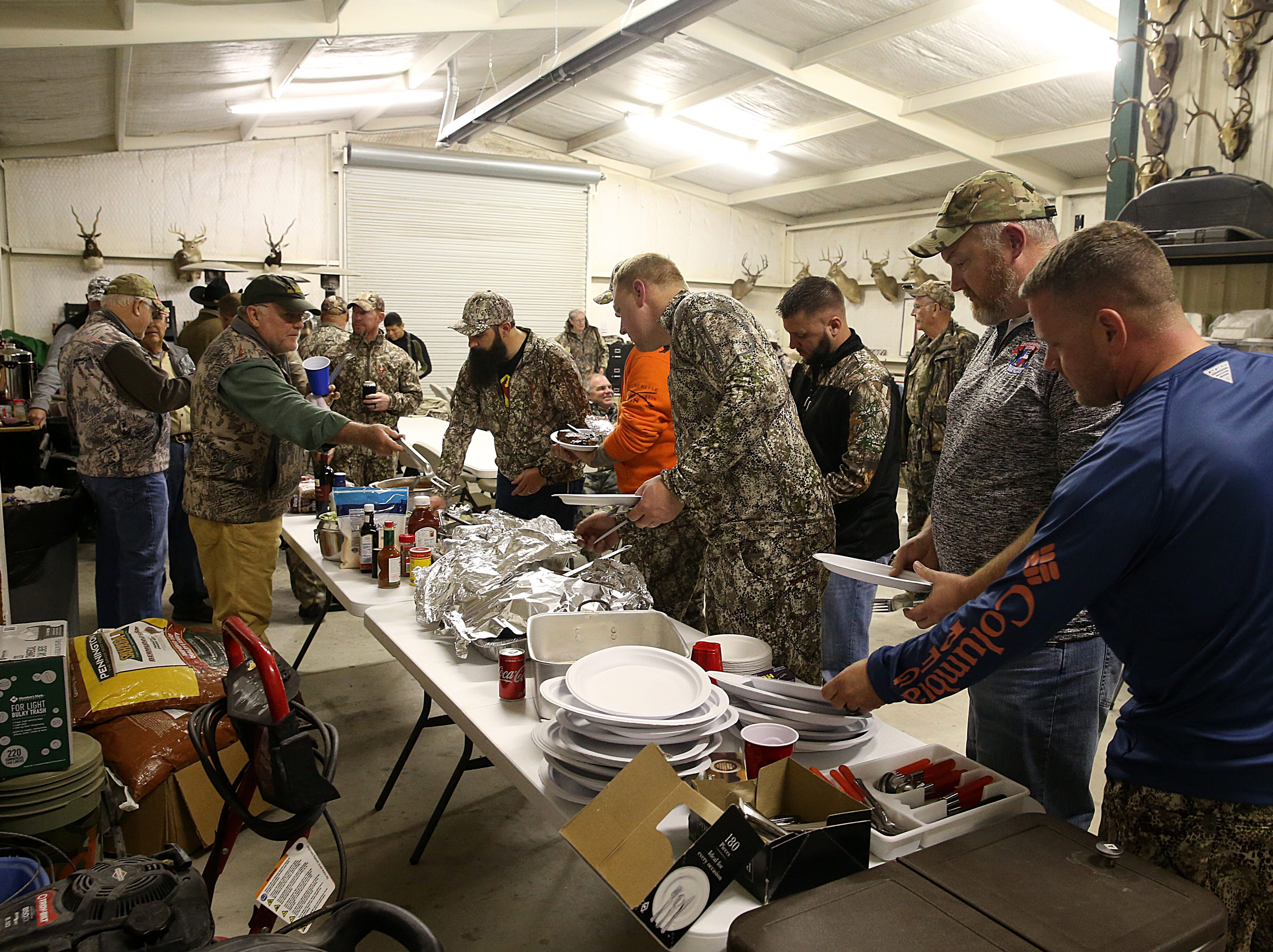 Hunters line up for dinner during the annual deer hunt in Christoval Friday, Dec. 7, 2018 sponsored by San Angelo Support for Veterans and Lone Star Warriors Outdoors.