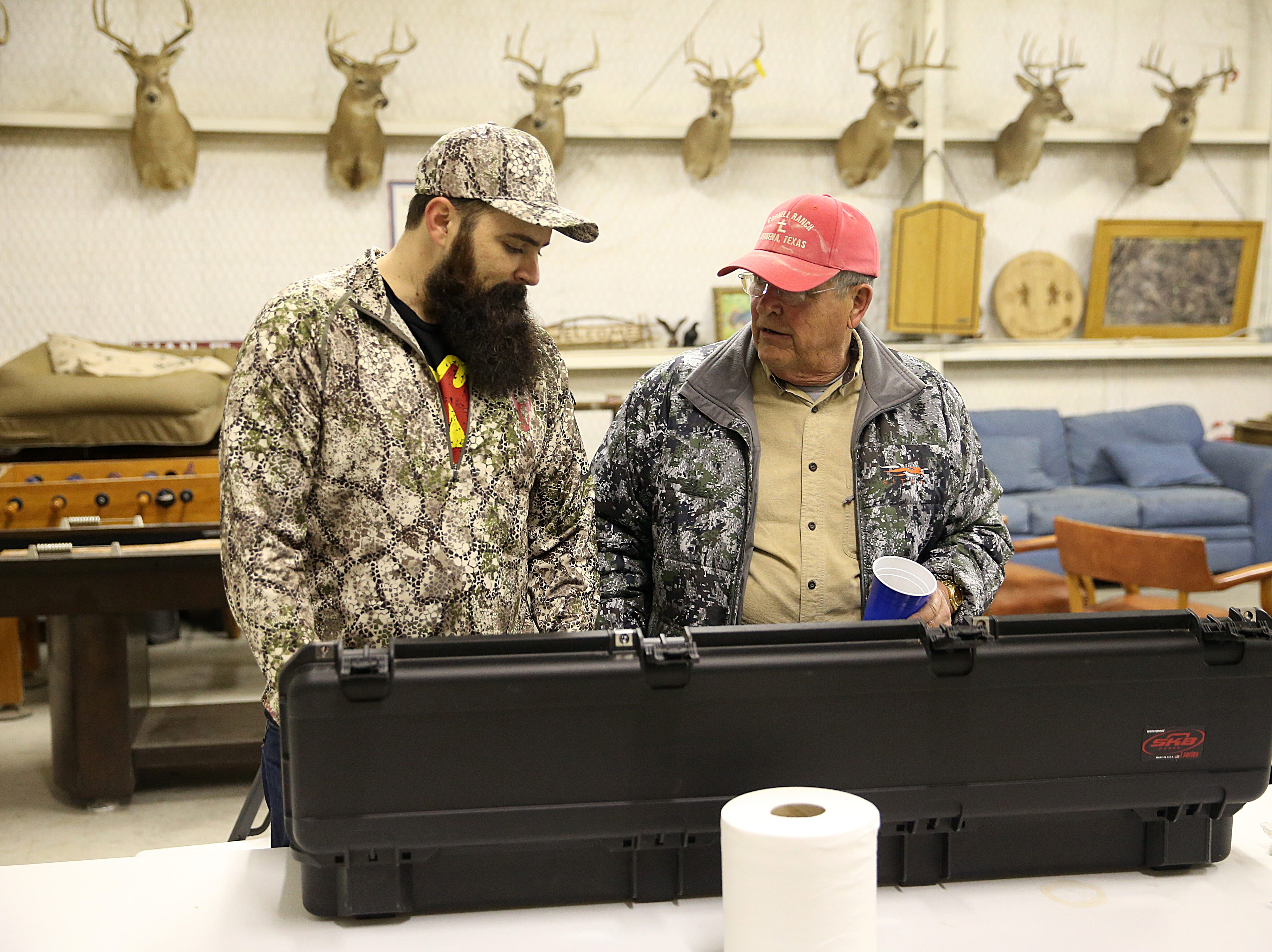 Joseph Lewis (left) shows off his new rifle to Mike Cornell during the annual deer hunt for veterans in Christoval on Friday, Dec. 7, 2018 sponsored by San Angelo Support for Veterans and Lone Star Warriors Outdoors.