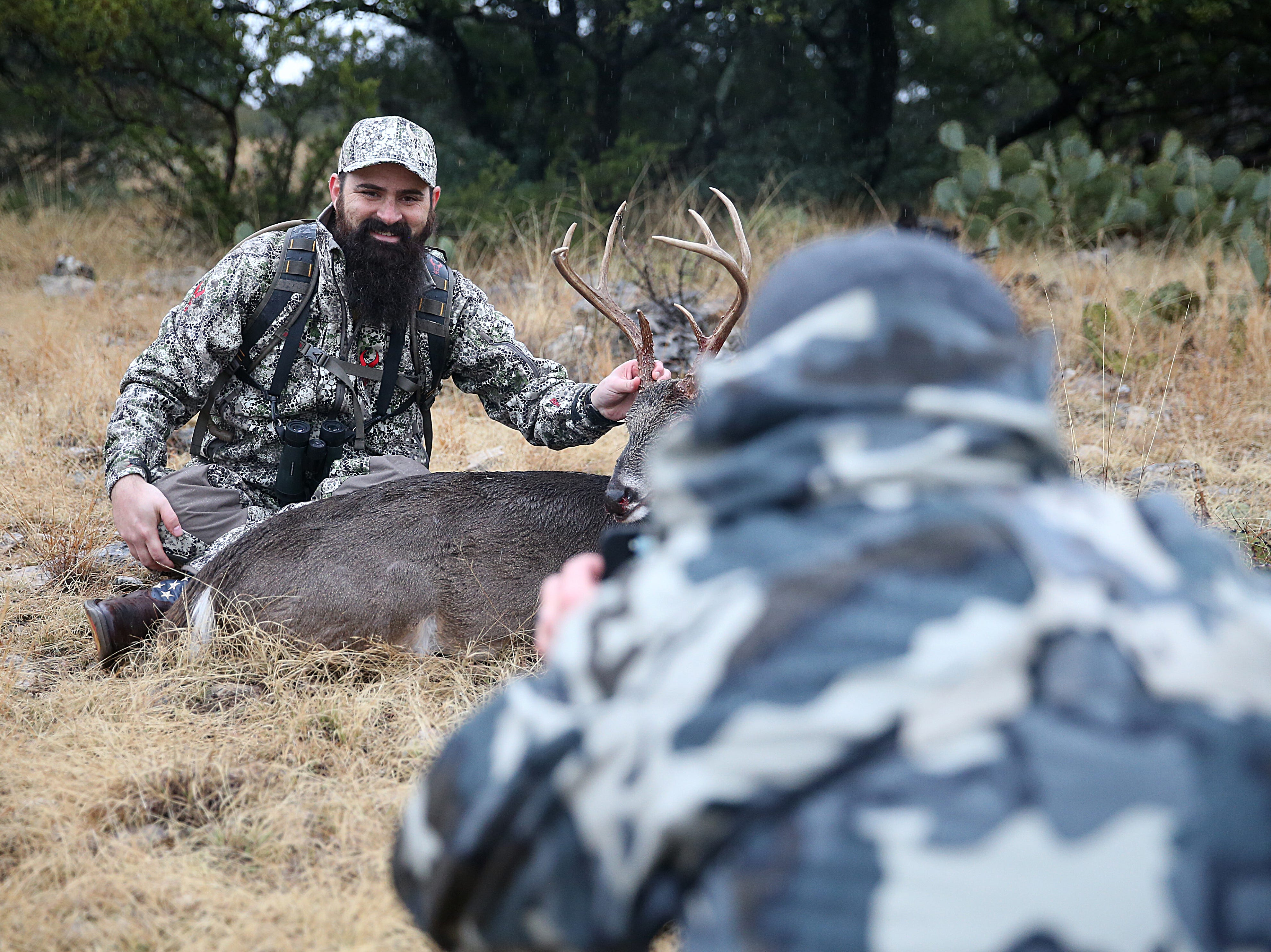 Joseph Lewis poses for a photo with his deer Friday, Dec. 7, 2018 during the annual deer hunt in Christoval sponsored by San Angelo Support for Veterans and Lone Star Warriors Outdoors.