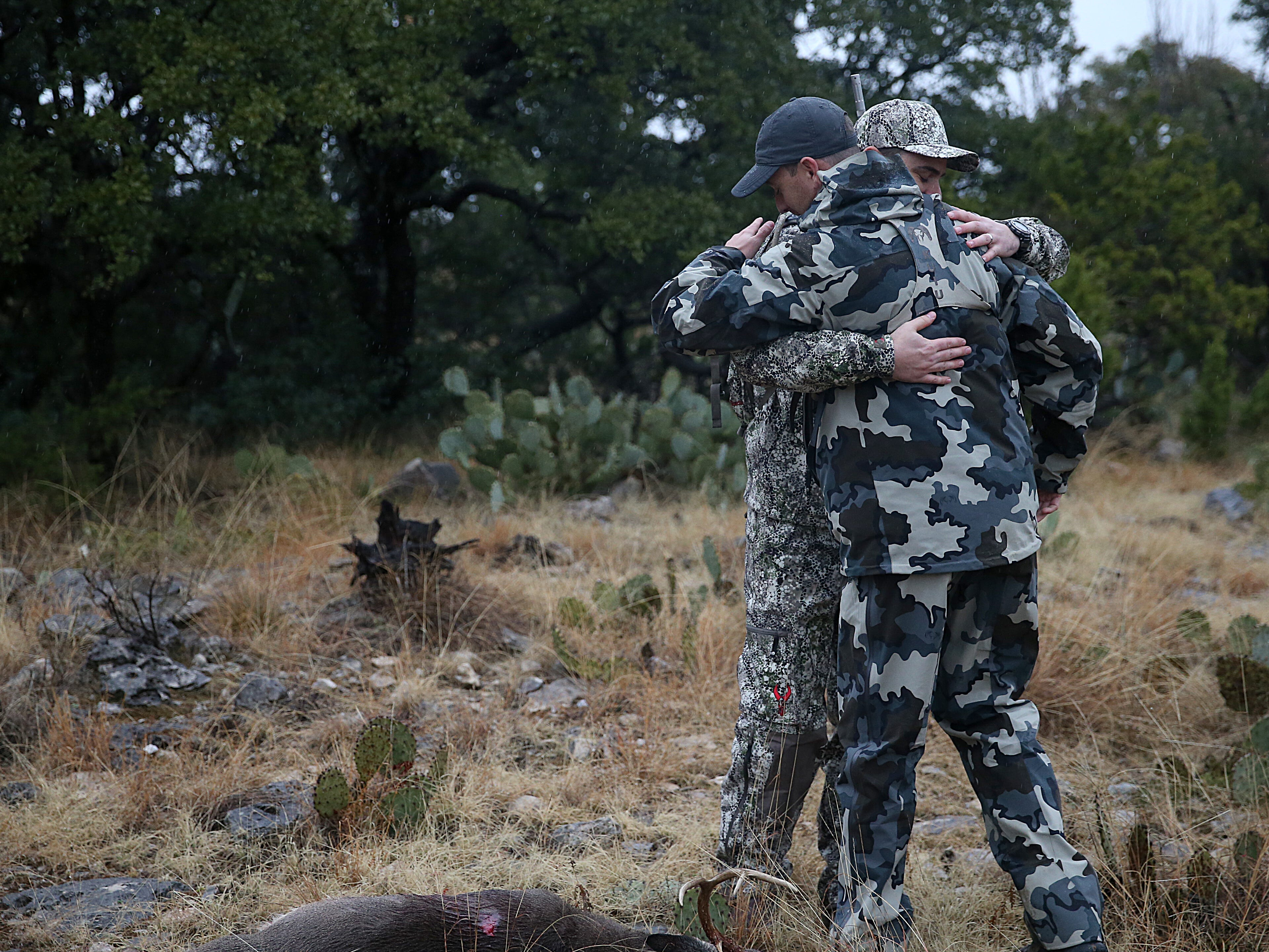 Joseph Lewis and his guide Ryan Dupriest embrace after Lewis shot his first deer during the annual deer hunt in Christoval Friday, Dec. 7, 2018 sponsored by San Angelo Support for Veterans and Lone Star Warriors Outdoors.The hunt included 18 combat injured veterans from across the nation.