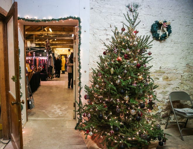 Shoppers visit the merchants in the fort buildings Friday, Dec. 7, 2018, during Christmas at Old Fort Concho.