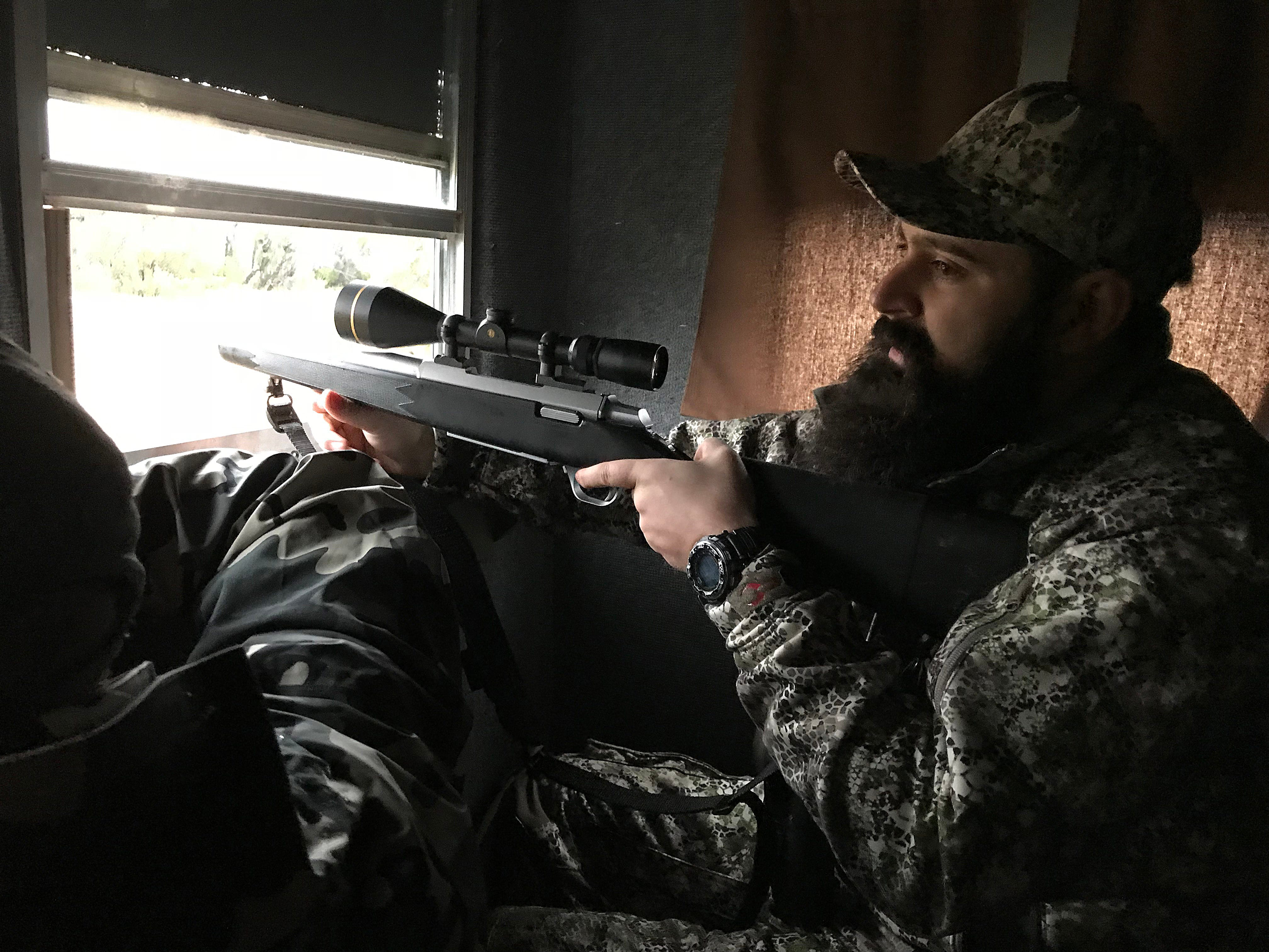 Joseph Lewis listens to directions from his guide Ryan Dupriest during the annual deer hunt in Christoval Friday, Dec. 7, 2018 sponsored by San Angelo Support for Veterans and Lone Star Warriors Outdoors.