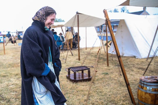 Emily Hopkins walks towards her camp Friday, Dec. 7, 2018, during Christmas at Old Fort Concho.