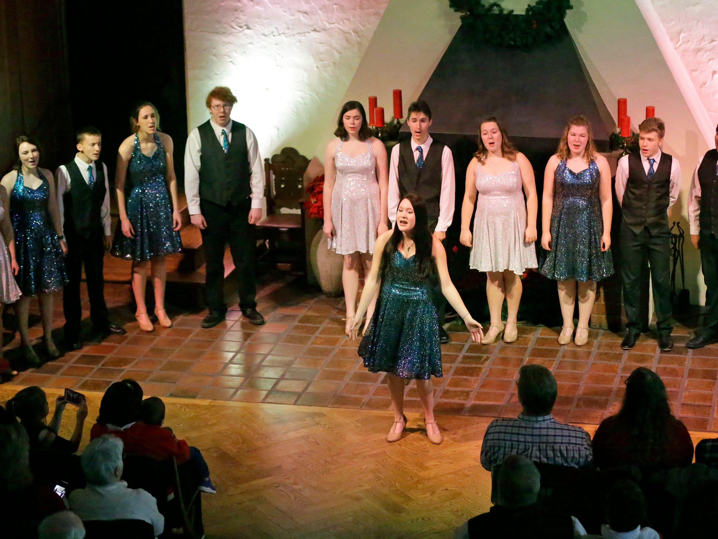 The Waves of Rhythm Show Choir from Kiel High School performs at the Waelderhaus, Saturday, December 8, 2018, in Kohler, Wis.