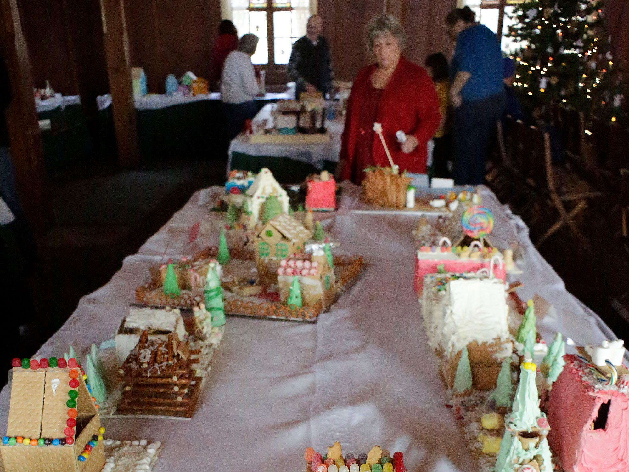A woman inspects a display at the annual Gingerbread Festival, Saturday, December 8, 2018, in Kohler, Wis.