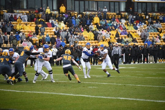 Mikey Daniel takes a handoff from Taryn Christion during South Dakota State's game against Kennesaw State on Saturday in Georgia.