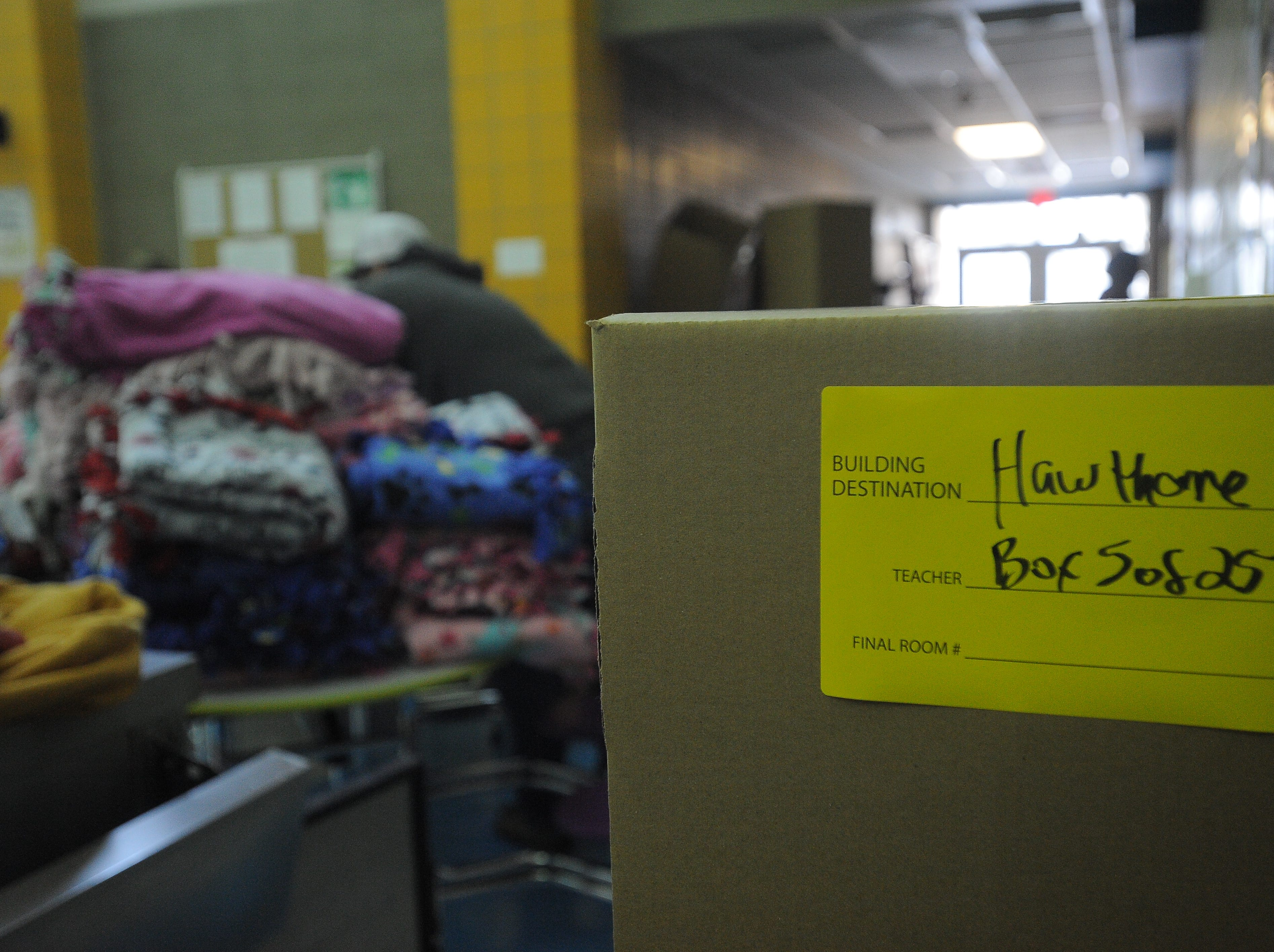 A box full of blankets is ready to be delivered to Hawthorne Elementary. Blankets were made by Project Warm-Up volunteers. Hundreds gathered Saturday, Dec. 8, 2018, to make thousands of blankets.