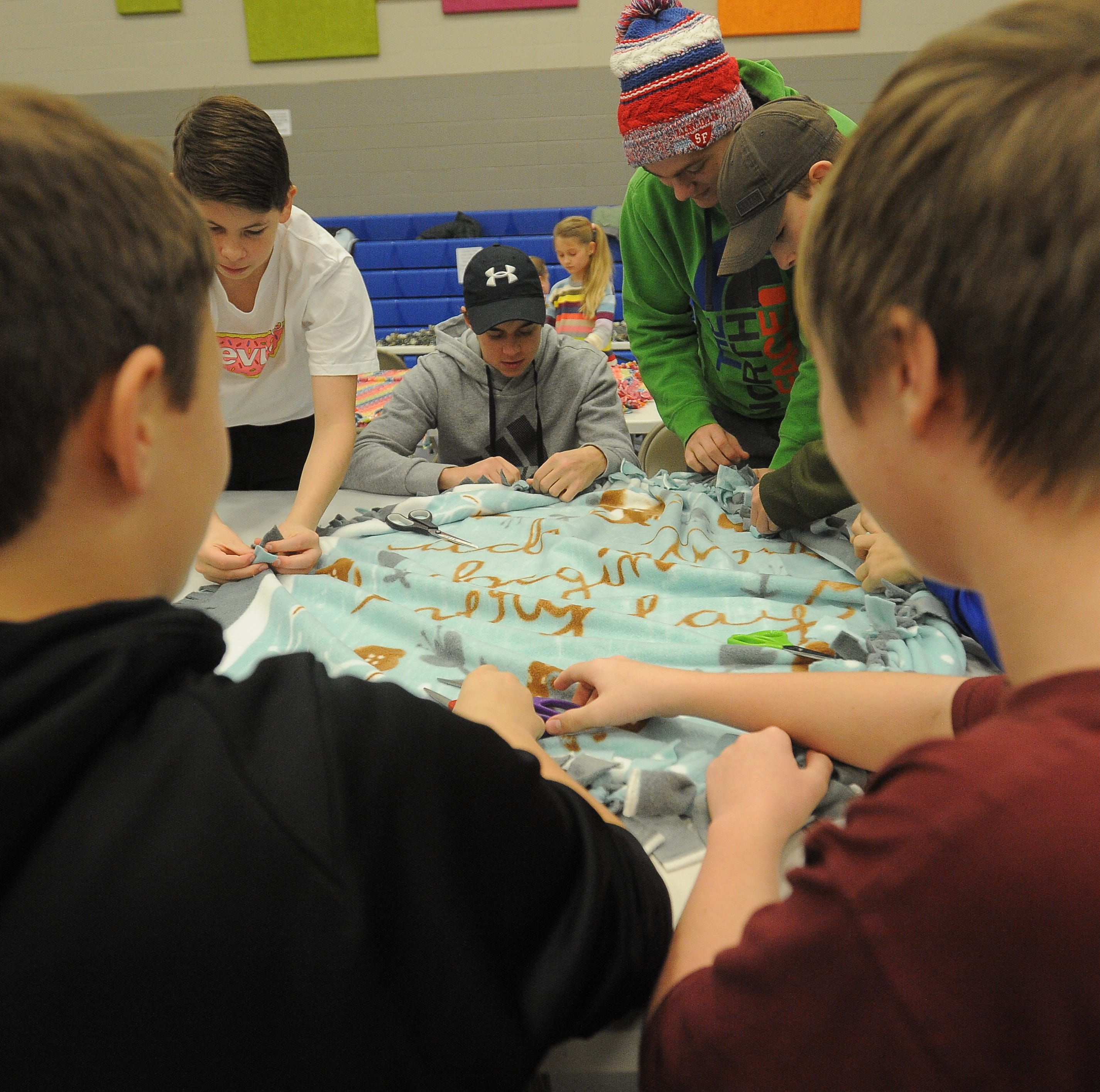 Project Warm-Up: Hundreds tie blankets for children in need