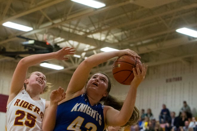 O'Gorman's Courtney Baruth (43) and Roosevelt's Mackenzie Risnes (25) go for the ball during a game, Friday, Dec. 7, 2018 at Roosevelt High School in Sioux Falls, S.D.