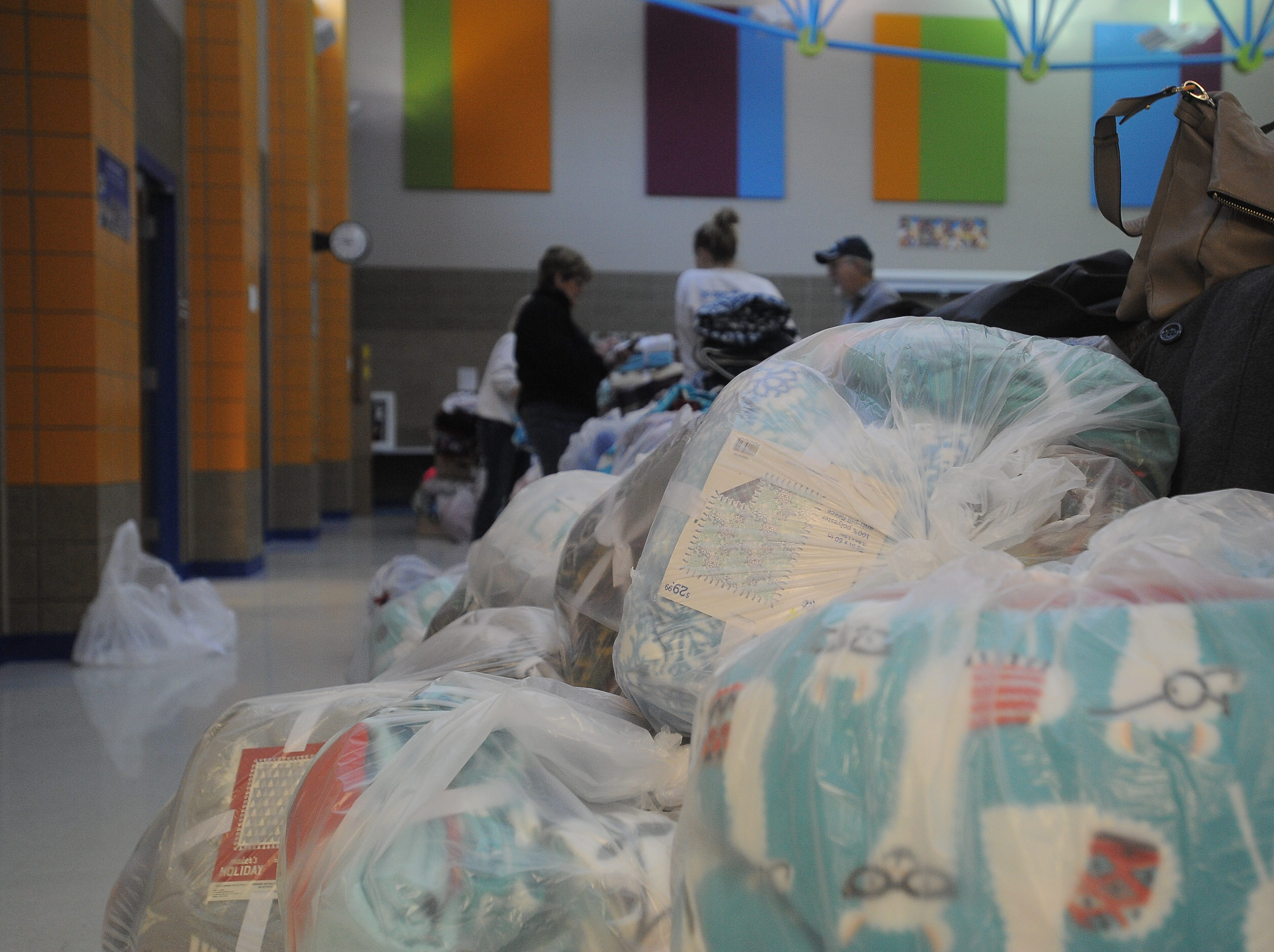 Project Warm-Up volunteers sort donated fabrics to make blankets for area children. Hundreds from the Sioux Falls area gathered Saturday, Dec. 8, 2018 at Sonia Sotomayor Elementary to help make blankets.