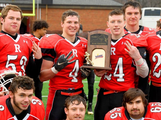 Riverheads' Blake Smith (4) and Jaden Phillips (24) hold up three fingers to represent three consecutive state titles after the Gladiators defeated Chilhowie 35-7 to win the VHSL Class 1 state championship on Saturday, Dec. 8, 2018 in Salem, Va.
