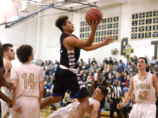 Lee High's Ethan Vest drives to the basket Friday in his team's win over Buffalo Gap.
