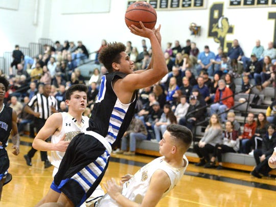 Lee High's Ethan Vest puts up a shot against Buffalo Gap Friday night.