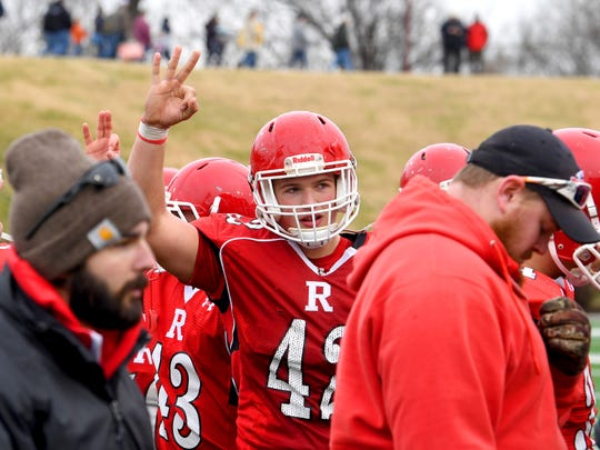 Riverheads' Moose Lee holds up three fingers to represent three consecutive state title wins after they defeat Chilhowie to win the VHSL Class 1 championship game in Salem on Saturday, Dec. 8, 2018.
