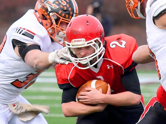 Riverheads' Devin Morris tries to slip through with the football during the VHSL Class 1 championship game in Salem on Saturday, Dec. 8, 2018.