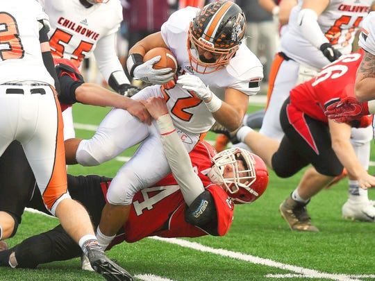 Riverheads' Jaden Phillips grabs onto a Chilhowie ballcarrier for the tackle during the VHSL Class 1 championship game in Salem on Saturday, Dec. 8, 2018.
