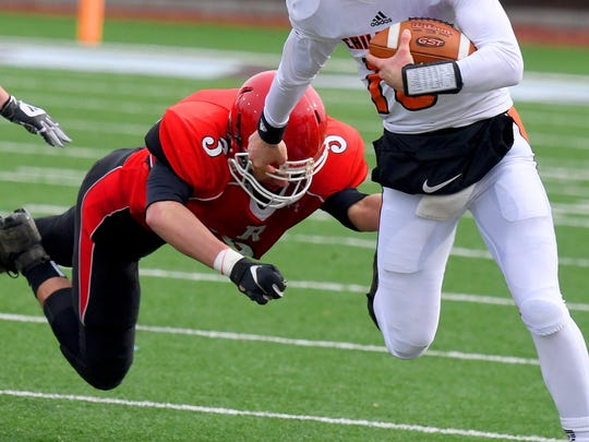 Riverheads' Drew Bond dives after a Chilhowie ballcarrier during the VHSL Class 1 championship game in Salem on Saturday, Dec. 8, 2018.