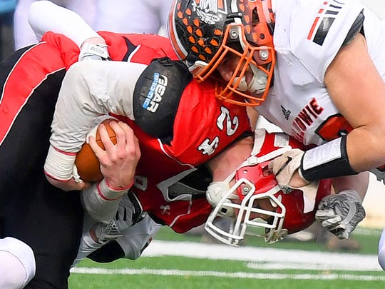 Riverheads' Jaden Phillips holds onto the ball as a Chilhowie player grabs onto his helmet by the earhole in an effort to drag Phillips down for the stop during the VHSL Class 1 championship game in Salem on Saturday, Dec. 8, 2018.