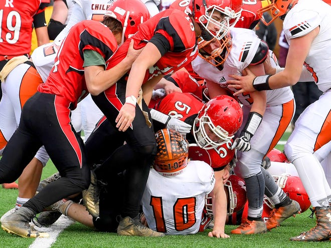 Riverheads' defenders pile on to make sure Chilhowie's Zack Cale goes down with the ball during the VHSL Class 1 championship game in Salem on Saturday, Dec. 8, 2018.