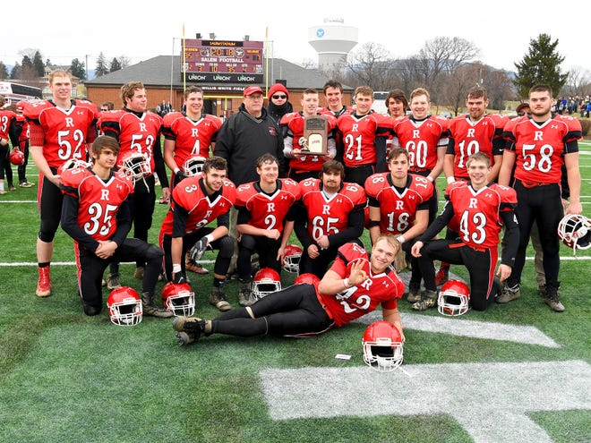 Riverheads' seniors with head coach Robert Casto after their winning the VHSL Class 1 championship game in Salem on Saturday, Dec. 8, 2018.