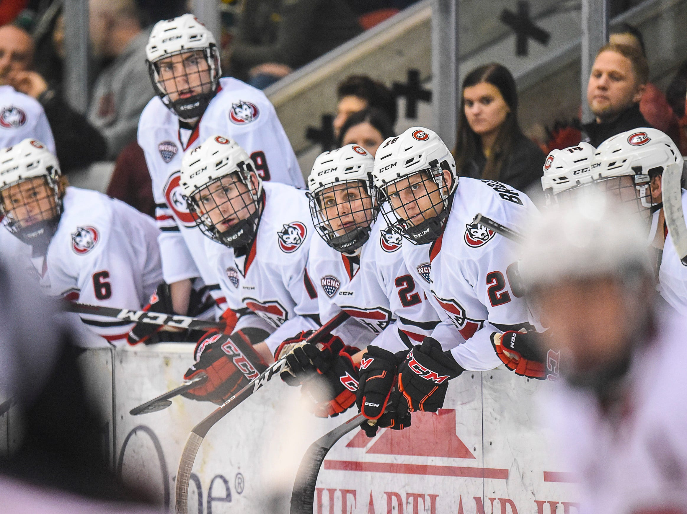 St. Cloud State players watch the action from the bench against the University of Nebraska-Omaha during the second period Friday, Dec. 7, at the Herb Brooks National Hockey Center.