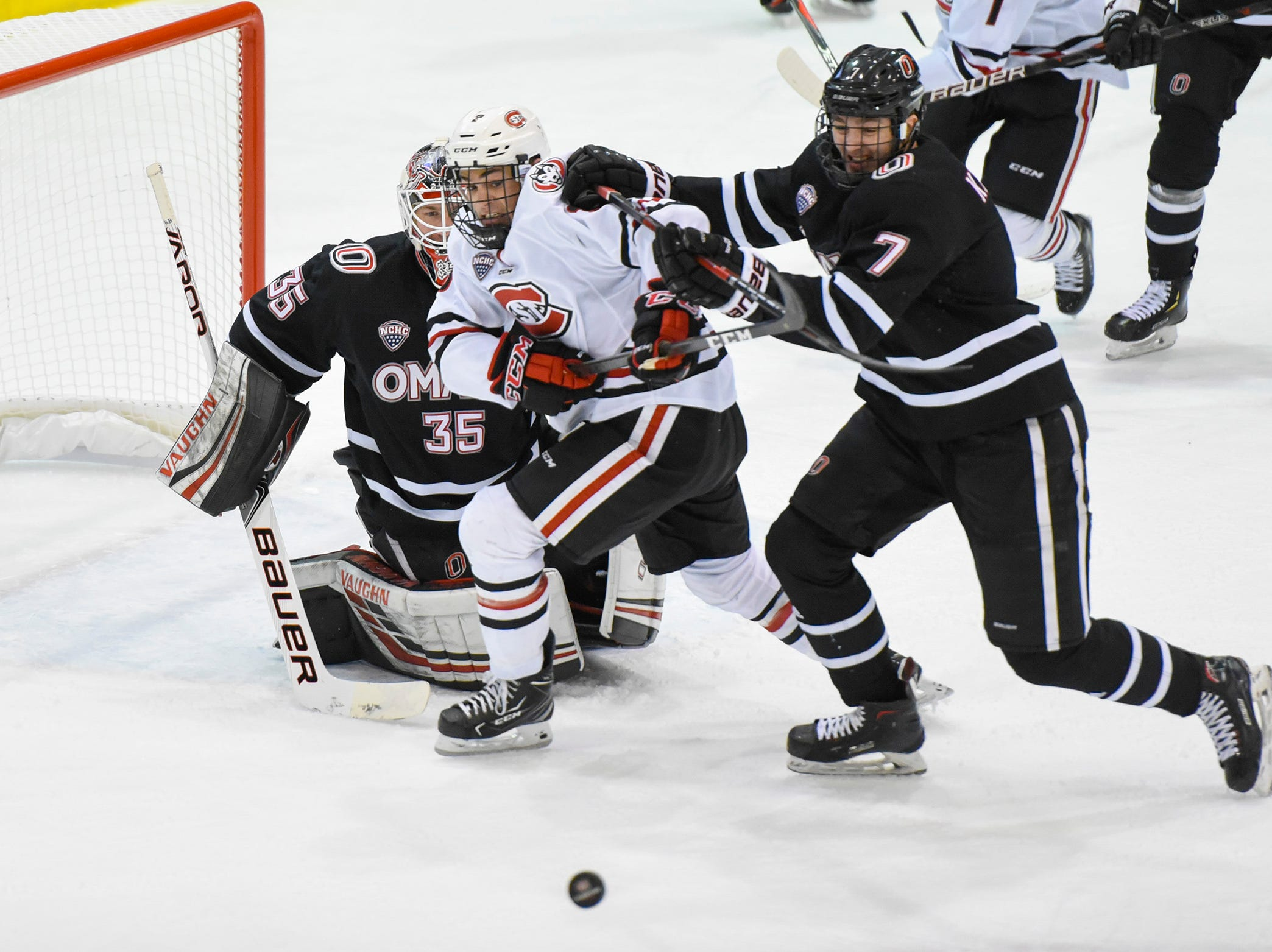 St. Cloud State's Jack Poehling has a shot on goal blocked against Nebraska-Omaha during the first period Friday, Dec. 7, at the Herb Brooks National Hockey Center.