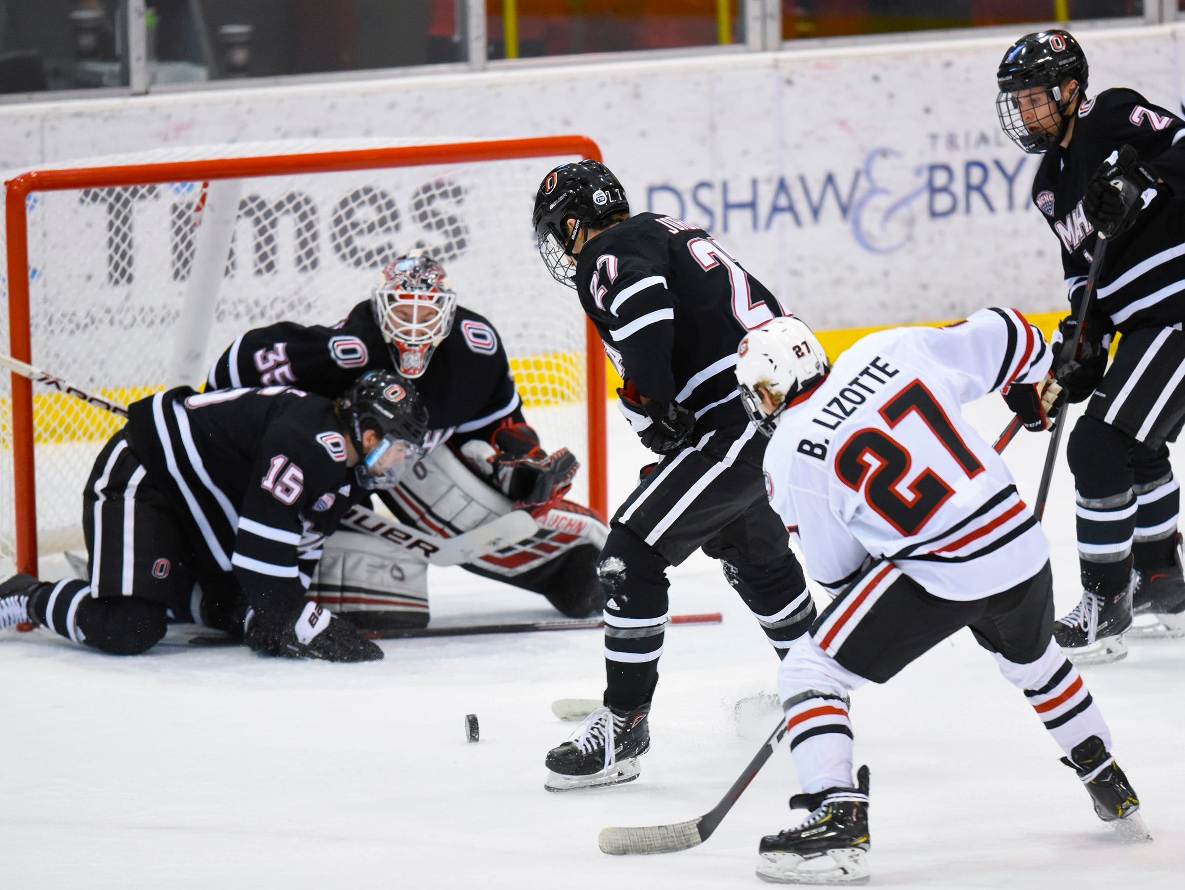 St. Cloud State's Blake Lizotte takes a shot at the Nebraska-Omaha goal during the first period Friday, Dec. 7, at the Herb Brooks National Hockey Center.
