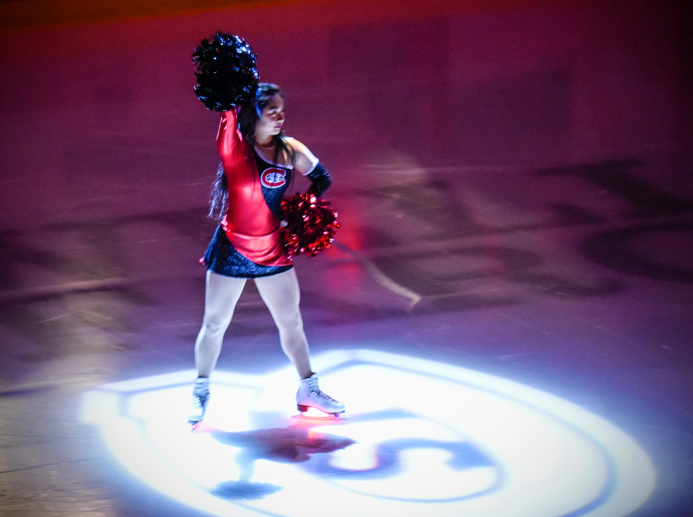 St. Cloud State University cheerleaders entertain the fans before the start of the game against the University of Nebraska-Omaha Friday, Dec. 7, at the Herb Brooks National Hockey Center.