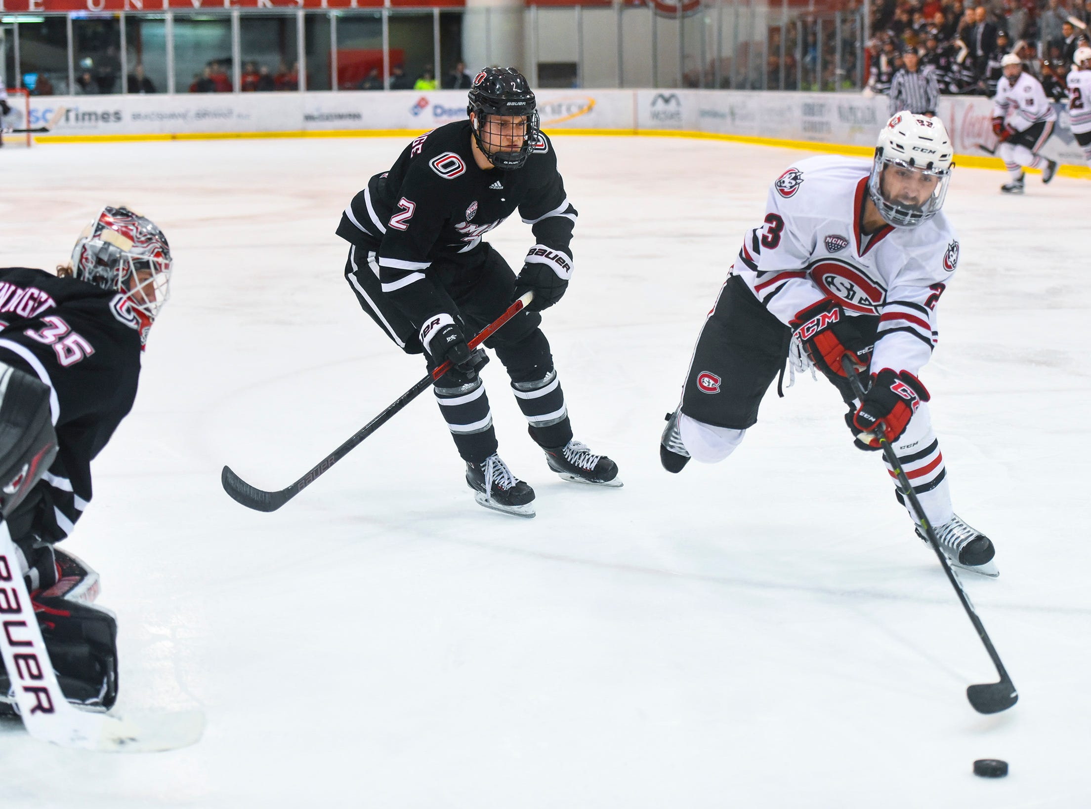 St. Cloud State's Robby Jackson tries to get the puck close to the Nebraska-Omaha goal during the second period Friday, Dec. 7, at the Herb Brooks National Hockey Center.