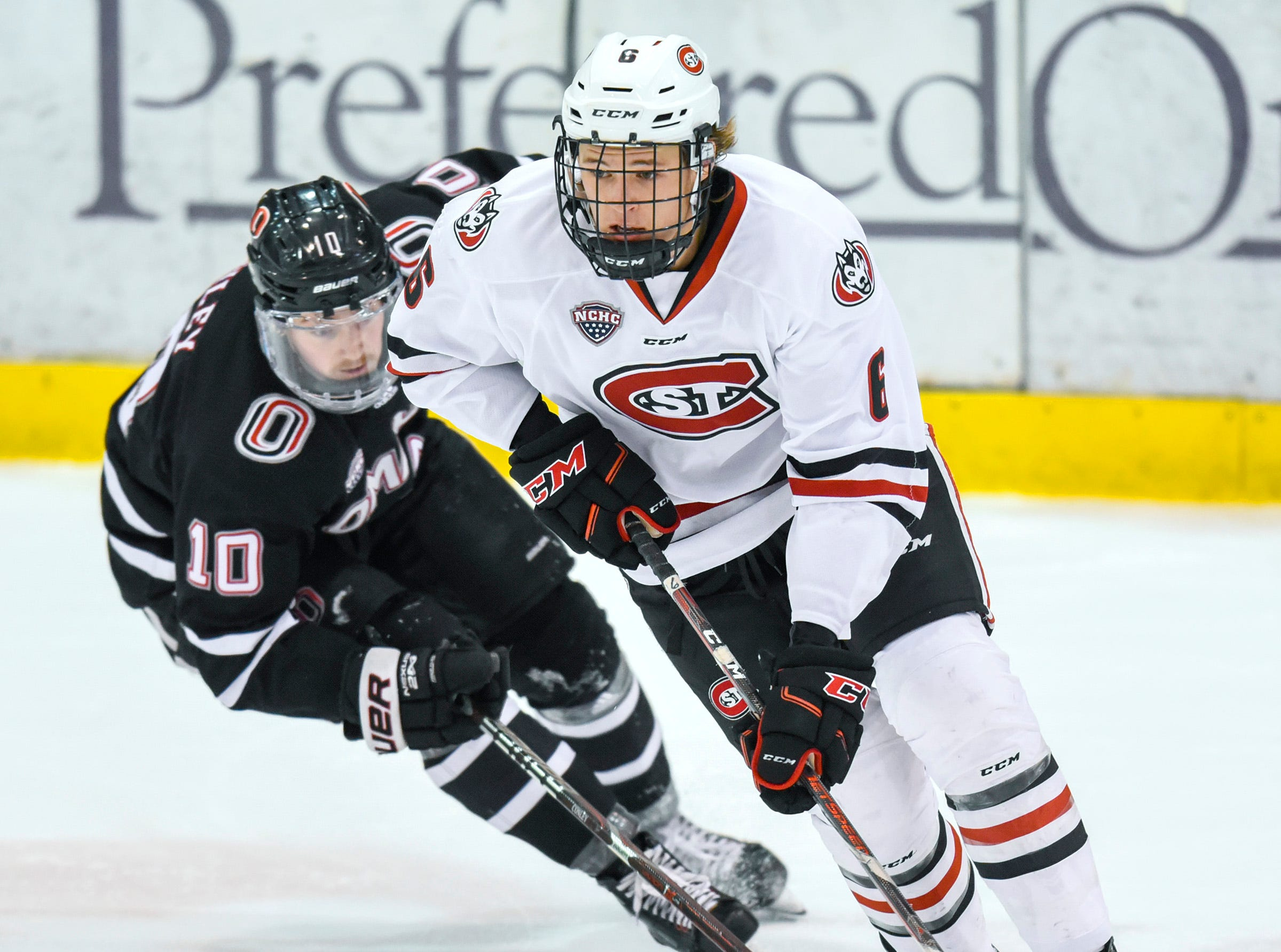 St. Cloud State's Luke Jaycox takes the puck past Nebraska-Omaha's Kevin Conley during the first period Friday, Dec. 7, at the Herb Brooks National Hockey Center.