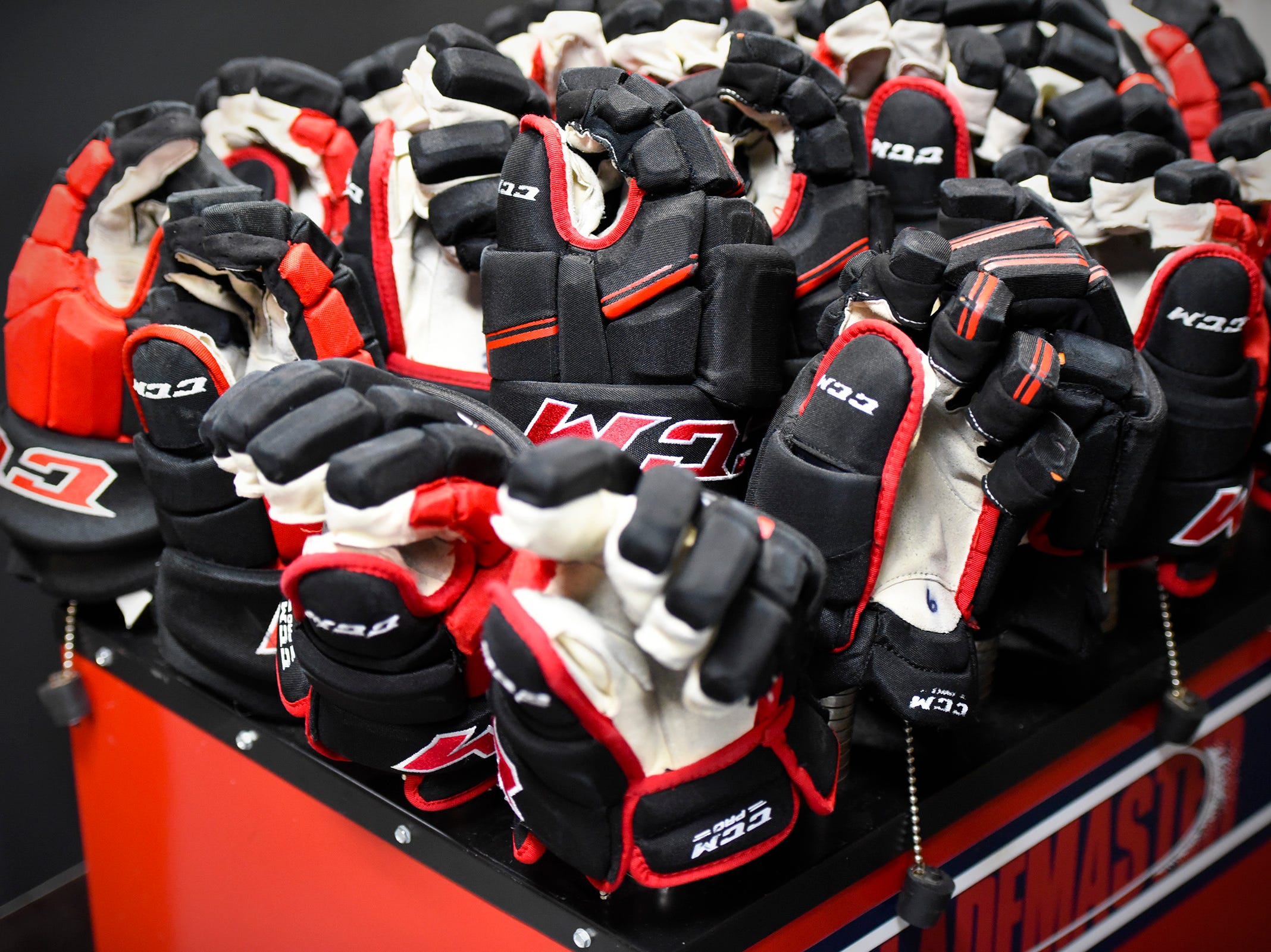 St. Cloud State University players gloves sit on a dryer while they are in the locker room between periods against the University of Nebraska-Omaha Friday, Dec. 7, at the Herb Brooks National Hockey Center.