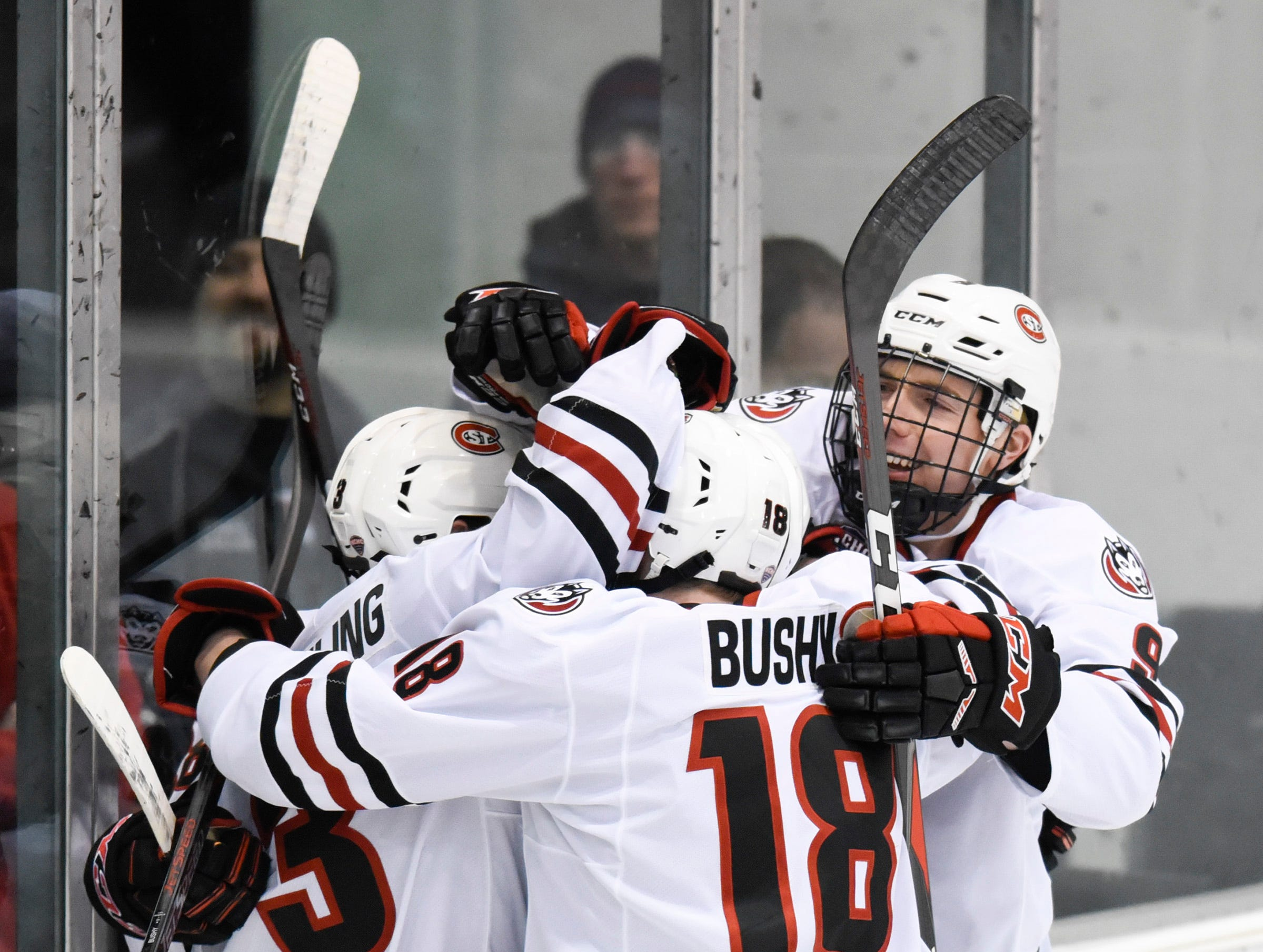 St. Cloud State University players celebrate a goal against the Nebraska-Omaha during the first period Friday, Dec. 7, at the Herb Brooks National Hockey Center.