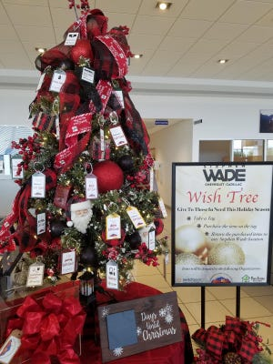 The Wish Tree at Stephen Wade Chevrolet Cadillac is decorated with tags noting items needed for area youth.