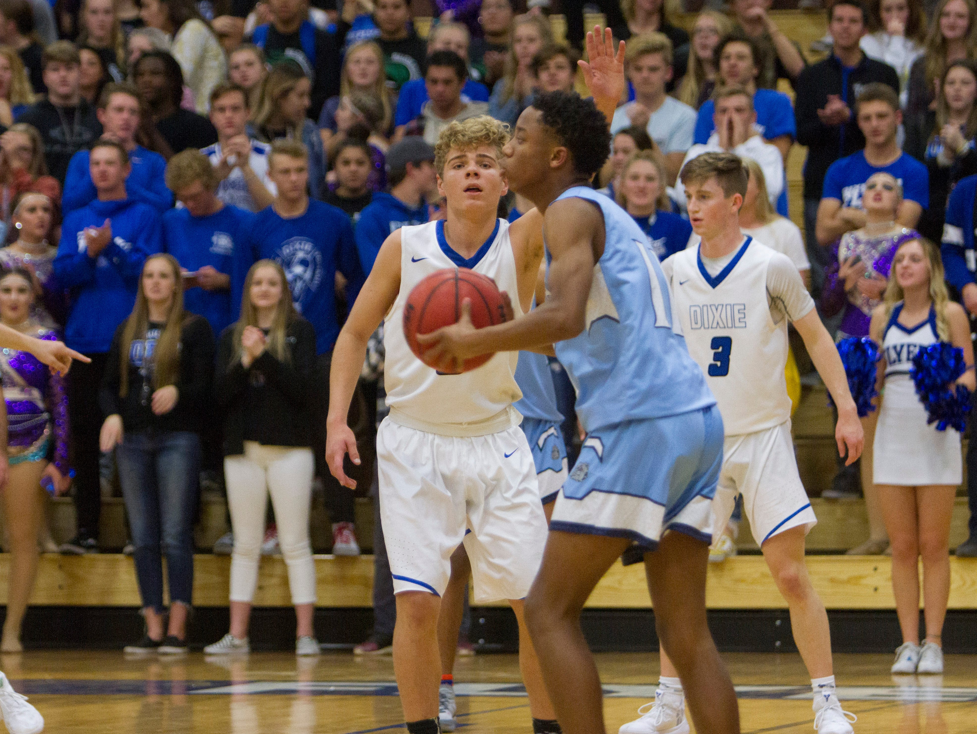 Dixie High basketball plays against Centennial High School during the Ken Robinson Classic Friday, Dec. 7, 2018.