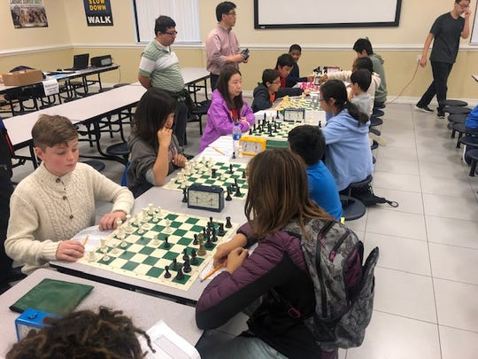 Students playing at the chess tournament at the School of Math and Science on Dec. 1.