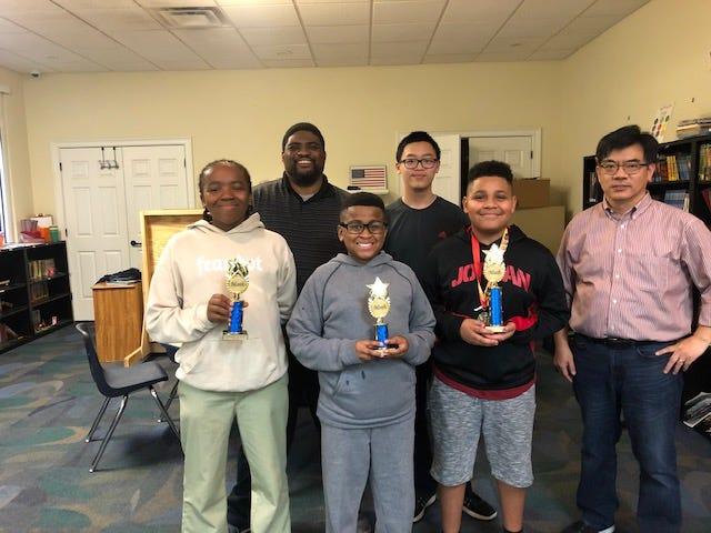 TSMS chess winners Carlos Martin Kamarian Washington Jaidyn Garcia.