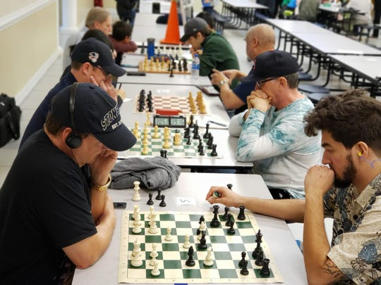 Adult open session at the recent chess tournament.