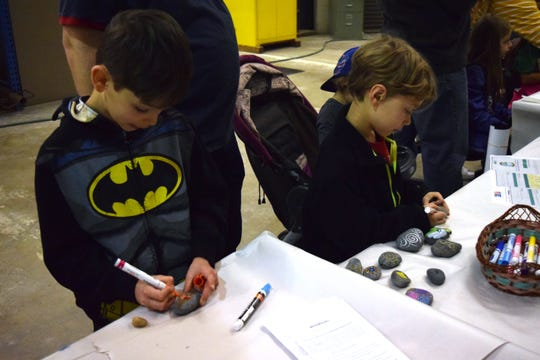 Anthony, 8, and Daniel, 6, paint rocks Saturday during the Florida Department of Environmental Protection's Geological Survey open house. It's a glimpse of what's to come in their studies next year when they start learning about geology.